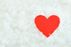 Red paper heart on snow background Stock Photo
