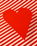 Red paper heart on striped background Royalty Free Stock Photos