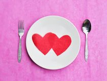 Red paper heart on white dish, love and valentine day concept an Stock Photo