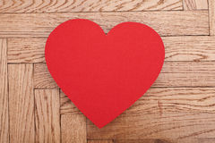 Red paper heart on wooden background Stock Photography