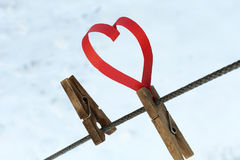 Red paper heart and a wooden clothespin on the rope Royalty Free Stock Photos