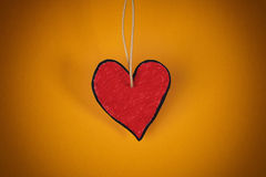 Red paper heart on a yellow background Stock Photography
