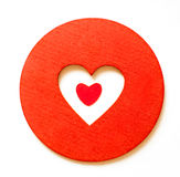 Red paper hearth inside a wooden red heart Royalty Free Stock Photo