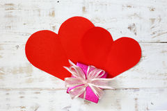 Red paper hearts copy space with gift box on white vintage wood Stock Photography