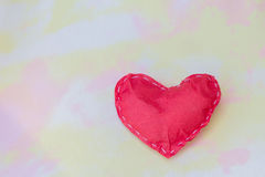 Red paper hearts on the fabric. Symbol of love abstract style background. Stock Images