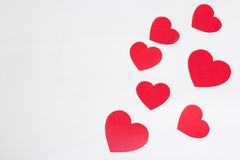 Red paper hearts over white with copy space Stock Photo