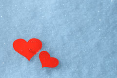 Red paper hearts in the snow. Greeting card for Valentine's Day. Stock Photo