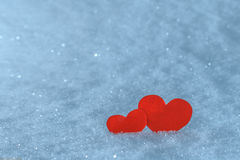 Red paper hearts in the snow. Greeting card for Valentine's Day. Royalty Free Stock Photography