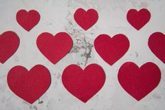 Red paper hearts on a white texture background Stock Photo