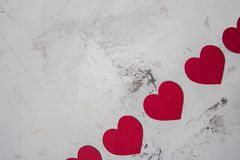 Red paper hearts on a white texture background, copy space Stock Image