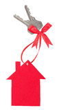 Red paper house with keys and a bow Stock Photos