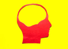 Red paper human head with hollow space. On yellow background Royalty Free Stock Photography