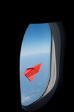Red paper plane in the blue sky .View from Window airplane. Red paper plane in the blue sky .View from Window airplane stock images