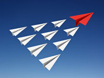 Red paper plane leads white paper planes in the blue sky leadership concept. 3D rendering royalty free illustration
