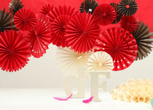Red paper rosettes Stock Photo