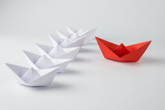 Red paper ship leading among white. Leadership concept with red paper ship leading among white Stock Photos