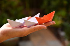 Red paper ship with white paper ship on hand human. Red paper ship with white paper ship on hand of human Stock Images