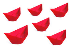 Red paper ships isolated on a white Royalty Free Stock Images