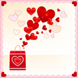 Red paper shopping bag with flying hearts Royalty Free Stock Photography