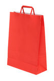 Red paper shopping bag isolated on white Stock Photos