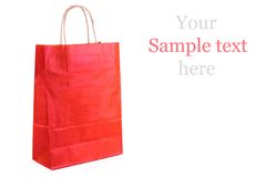 Red paper shopping bag isolated. Shopping concept. Royalty Free Stock Photos