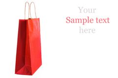 Red paper shopping bag isolated. Shopping concept. Stock Image