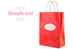 Red paper shopping bag isolated. Shopping concept. Royalty Free Stock Images