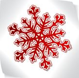 Red paper snowflacke over blank sticker Stock Images