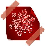 Red paper snowflake over red sticker Royalty Free Stock Images