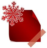 Red paper snowflake over red sticker Royalty Free Stock Photo