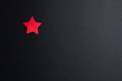 Red paper star on a black background Stock Photos