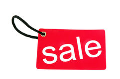 Red paper tag labeled with sale words Royalty Free Stock Images