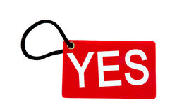 Red paper tag labeled with yes words Royalty Free Stock Image