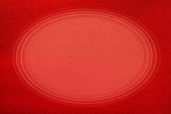 Red paper texture. Red decorative paper close-up. Texture or background with copy space in center Royalty Free Stock Photo