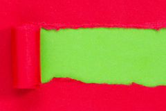 Red paper torn to reveal green panel Royalty Free Stock Photos