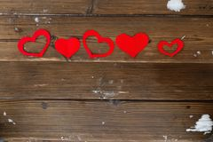 Red paper Valentine hearts on wooden background. Valentine`s day gift stock photography
