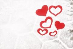 Red paper Valentine hearts on snow. Valentine`s day gift. Red paper Valentine hearts on white snow. Valentine`s day gift royalty free stock image