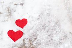 Red paper Valentine hearts on snow. Valentine`s day gift. Red paper Valentine hearts on white snow. Valentine`s day gift stock images