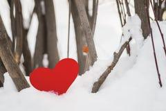 Red paper Valentine hearts on snow. Valentine`s day gift. Red paper Valentine hearts on white snow. Valentine`s day gift royalty free stock photo