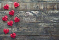 Red paper valentine hearts on wooden background. Space to copy. Red Valentine Hearts on wooden bottom. Overhead plane with space to write Stock Photography
