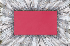 Red Paper on wood Stock Photo