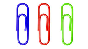 Red paperclip on white background. Stock Photos