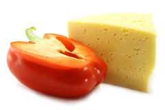 Red paprica and cheese. On the white background Stock Images