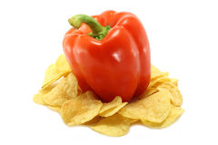 Red paprica and chips. On the white background Royalty Free Stock Photos