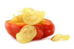 Red paprica filled a chips. On the white background Stock Images