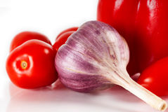 Red paprica, garlic and tomatoes Stock Image