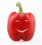 Red paprika. Friendly smile from a red paprika isolated on white with clipping path Stock Photography