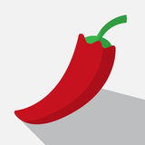 Red paprika and long shadow Stock Photography
