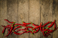 Red paprika over wooden table Royalty Free Stock Image