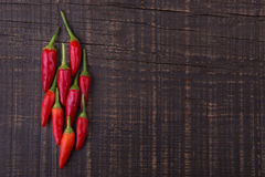 Red paprika pepper on wooden texture for text. Stock Photos